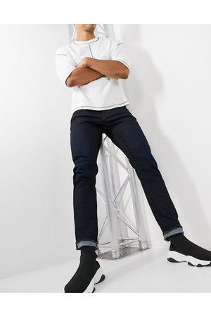 G-Star – 3301 – Mörka straight jeans i avsmalnande modell