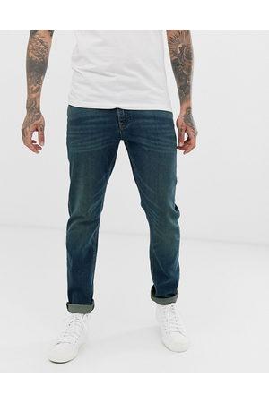 ASOS – Mörkblå slim jeans i vintagetvätt med stretch