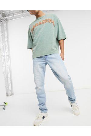 ASOS – Slim jeans med blekt vintage-tvätt