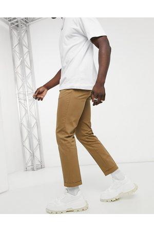 Burton Beiga ankellånga byxor i smal modell