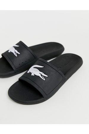 Lacoste – Svarta tofflor med krokodillogga
