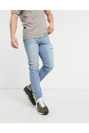 ASOS – Ljusblå skinny jeans i vintagetvätt med slitna detaljer