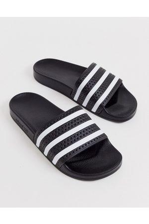 adidas – Adilette – Svarta tofflor