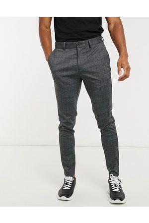 Jack & Jones Intelligence – Mörkgrå rutiga byxor i jersey med smal passform