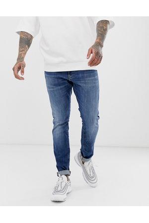 G-Star – Mellanblå skinny jeans med åldrad stil