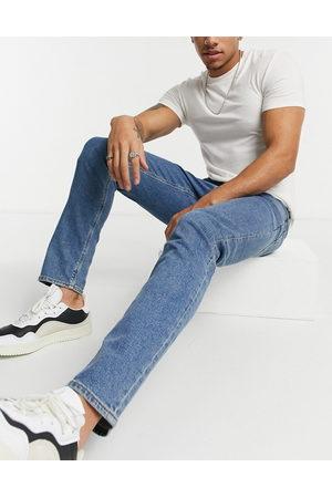 ASOS – Mellanblå slim jeans med stretch
