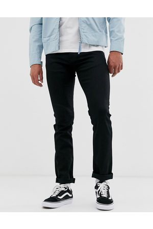 Nudie Jeans Co – Grim Tim – Svarta slim jeans i straight fit