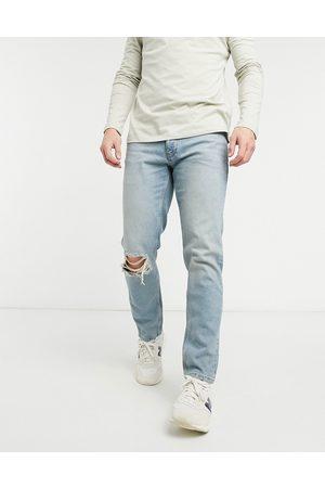 ASOS – Mellanblå vintageinspirerade smala jeans i 90-tals tvätt med låg midja och knäreva