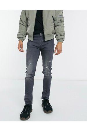 ASOS – skinny jeans med slitna detaljer