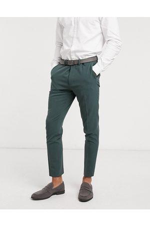 ASOS – Skogsgröna kostymbyxor med supersmal passform