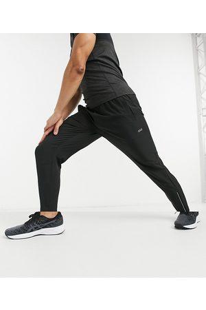 ASOS – Vävda avsmalnande löparbyxor i skinny passform med reflex-dragkedja
