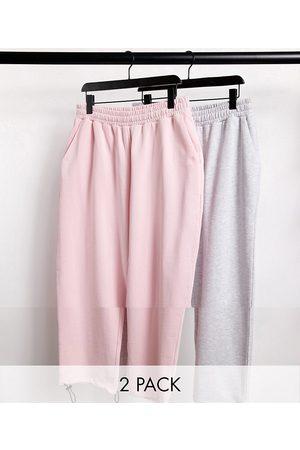ASOS – Vitmelerade och rosa mjukisbyxor i 2-pack med oversize och dragskor i bensluten-Flera färger