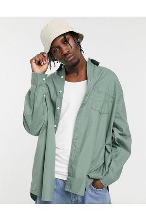 ASOS – Mörkgrön flanellskjorta i extrem oversize