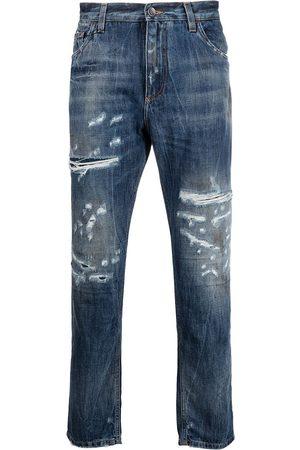 Dolce & Gabbana Croppade jeans med slitna detaljer