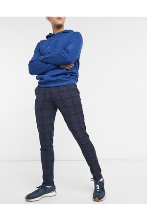 ASOS – Marinblå kostymbyxor med litet rutmönster och supersmal passform