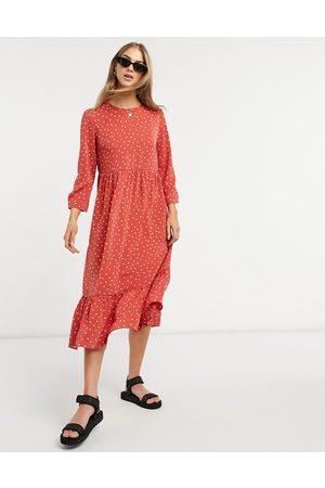 Glamorous – blommig midiklänning med smock och peplum nedtill