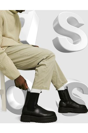 ASOS – Svarta vadhöga chelseaboots i läderimitation