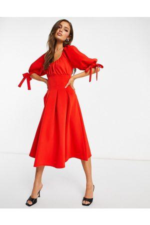 ASOS – Morotsfärgad midiklänning i skatermodell med puffärmar och korsett-Flera färger