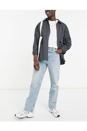 ASOS – Ljusblå vintagetvättade jeans med avslappnad passform