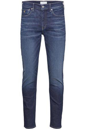 Calvin Klein Slim Taper Slimmade Jeans Blå