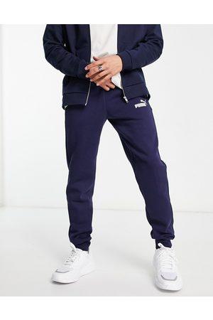 PUMA – Essentials – Marinblå mjukisbyxor med smal passform och liten logga