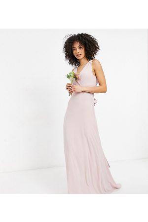 TFNC – Brudtärna – Minkfärgad maxiklänning med djup urringning och rosett baktill-Pink