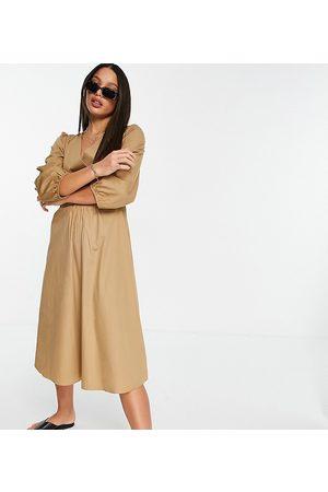 Y.A.S – midiklänning med omlottdesign