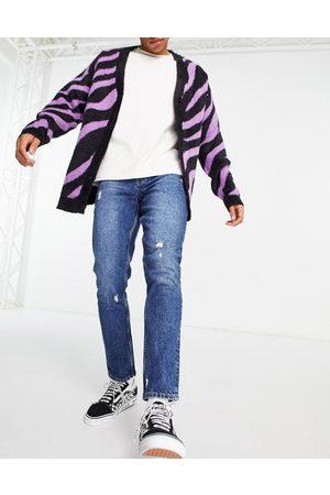 ASOS – Mörkblå smala jeans med slitna detaljer