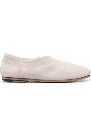 Officine creative Closed back slippers