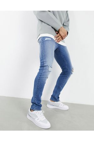 ASOS – Mellanblå skinny jeans med stora revor