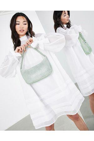 ASOS – Vitrutig miniklänning i organza med fickdetalj-Vita