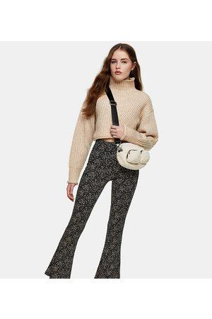 Topshop – Småmönstrade utsvängda byxor i jersey-Olika färger
