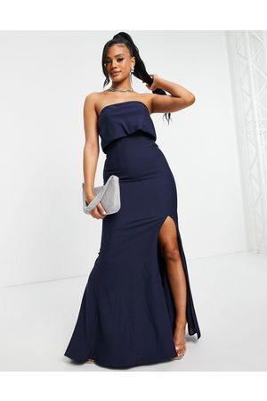 Jarlo – Marinblå maxiklänning i bandeaumodell med lårslits och överlager upptill