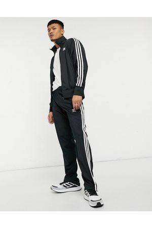 adidas – adicolor Firebird – Svarta mjukisbyxor med tre ränder