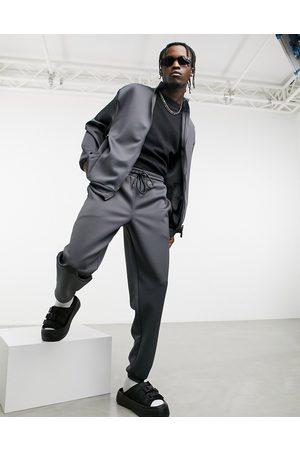 ASOS – Grafitgrå oversized träningsoverall med jacka och mjukisbyxor i scuba-material