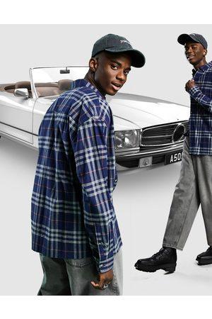 ASOS – Rutig borstad flanellskjorta i oversize och 90-talsstil-Marinblå