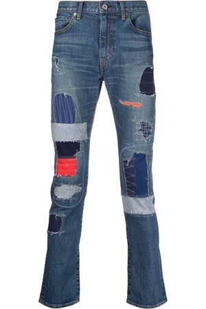 JUNYA WATANABE Slim fit-jeans med lappteknik