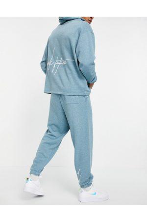 ASOS – Blåmelerade mjukisbyxor i oversize och urtvättad finish, del av set