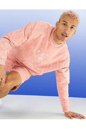 ASOS – Persikorosa stentvättad sweatshirt i oversize med målade linjer, del av set