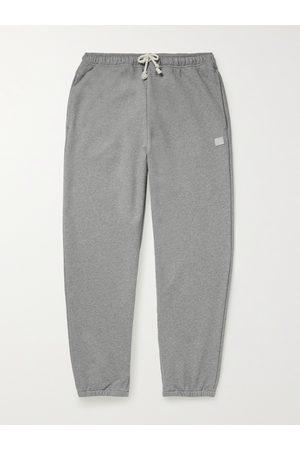 Acne Studios Man Joggingbyxor - Tapered Logo-Appliquéd Cotton-Jersey Sweatpants