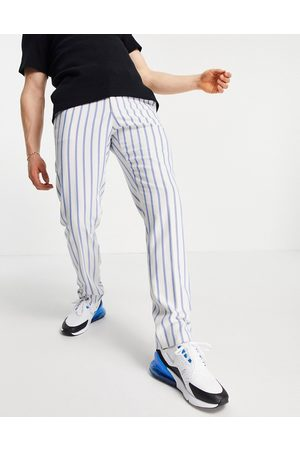 ASOS – Blårandiga, figursydda och mjuka kostymbyxor med smal passform och joggingresår