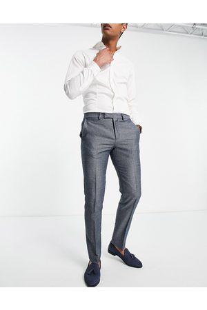 Twisted Tailor – och vita kostymbyxor med litet jacquardvävt geometriskt mönster