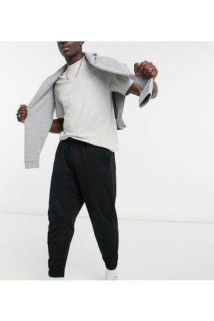 ASOS Man Joggingbyxor - – Svarta mjukisbyxor i oversize-modell