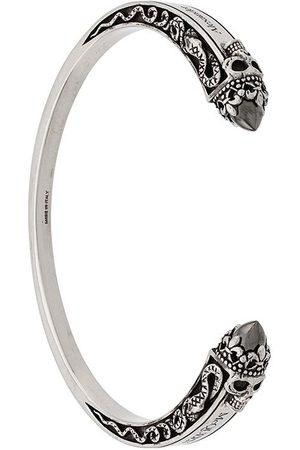 Alexander McQueen Graverat armband med dödskalle