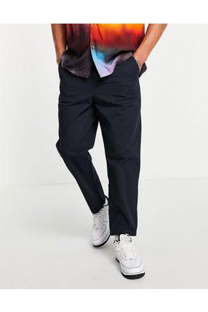 Farah – Hawtin – Marinblå byxor i avslappnad passform