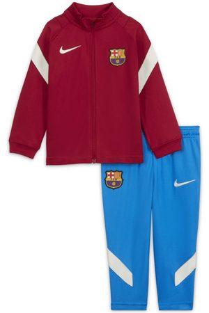 Nike Stickade tröjor - Stickad fotbollstracksuit FC Barcelona Dri-FIT Strike för baby/små barn