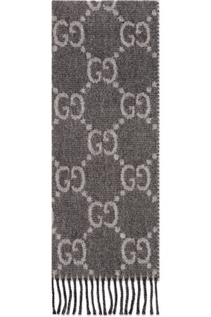 Gucci GG jacquard pattern knit scarf with tassels