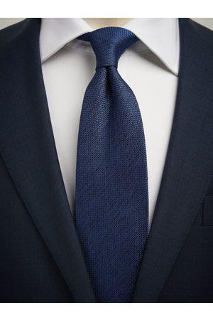 John Henric Blue Tie Structure