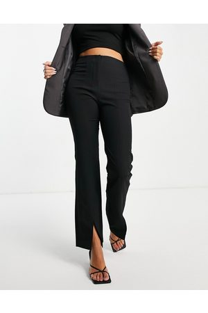 ASOS – Kritstrecksrandiga smala kostymbyxor i dad-modell med slits-Flera
