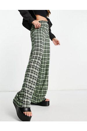 ASOS – Neonfärgade rutiga kostymbyxor i jersey med vida ben-Flera